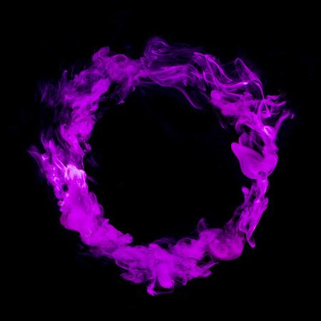 pink colorful smoke circle isolated on black background