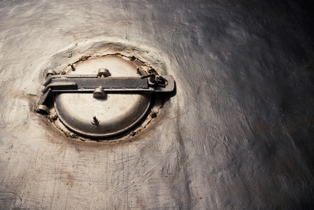 Closed circle manhole inside wall