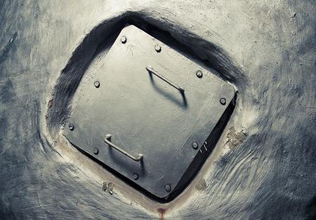 square manhole cover inside wall