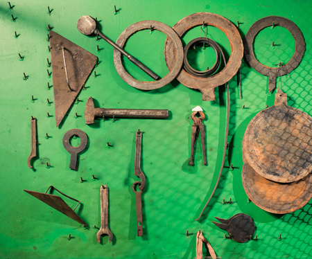 old rusty metallic instruments and tools