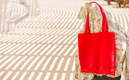 red bag on sunbed at pool area