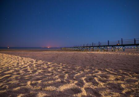 summer night scenic on sandy beach