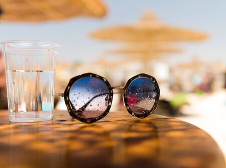 sunglasses on summer wooden table