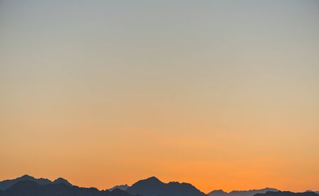 sunset line over mountains