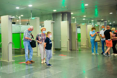 11.07.2020 - Kiev, Ukraine tourists in face masks after crossing borderline in international airport