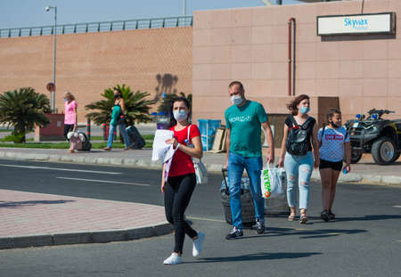 Egypt, Hurghada - 07/11/2020. tourists in protective masks after arriving leaving airport area Editorial