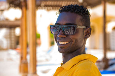 Egypt, Hurghada - 07/16/2020. smiling portrait of egyptian hotel staff lifeguard worker at swimming pool area on background Editorial