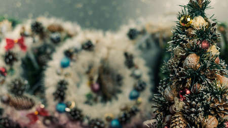 Christmas tree and wreaths on abstract background
