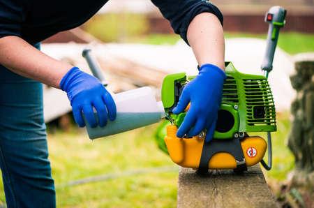 grass-cutter preparing to work on spring farmland soil