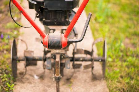 plowing mechanism ready to work on spring farmland soil