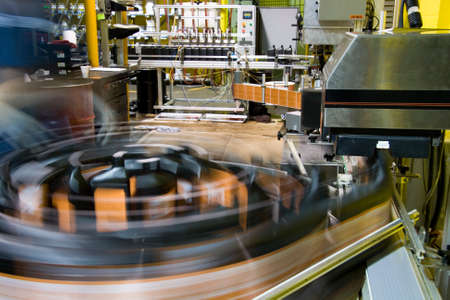 factory automation: Turntable of bottling line at a lubricant manufacturing facility Stock Photo