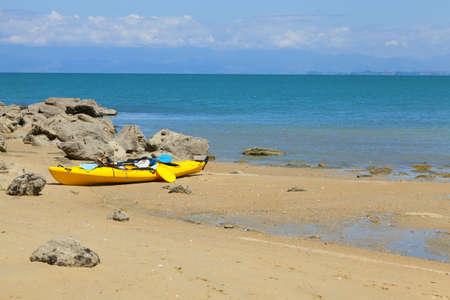 new zealand beach: Sea kayak on the beach Stock Photo