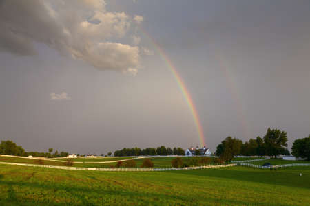 Rainbow over a horse farm photo