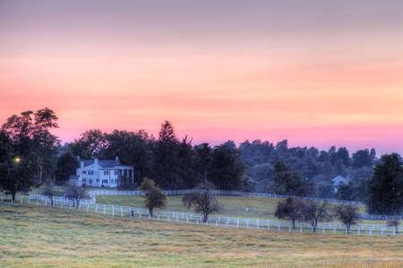 Sunset on a horse farm photo