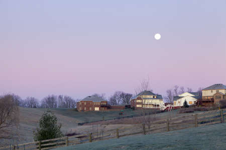 rural development: Moonset over a suburban neighborhood