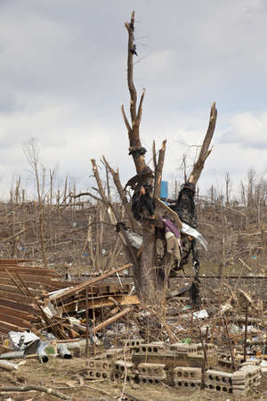 reported: Henryville, IN – March 4, 2012: Aftermath of category 4 tornado that touched down in town on March 2, 2012 in Henryville, IN. 12 deaths and massive loss of property were reported in Indiana as results of series of tornados