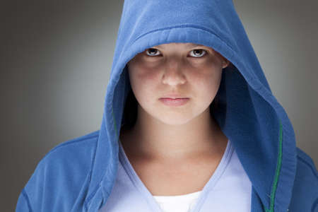 Girl in a blue hooded jacket photo
