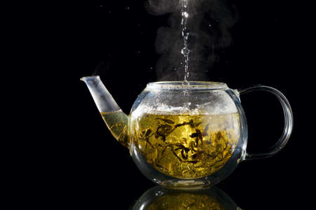 condensate: Brewing fresh green tea in a glass teapot
