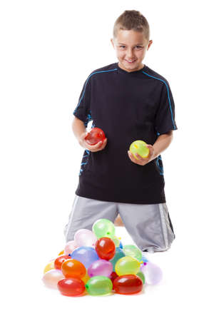 Boy with water balloons photo