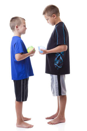 tall and short: Boys with water balloons