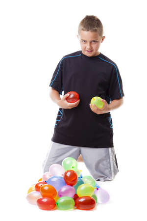 wet t shirt: Boy with a pile of water balloons Stock Photo