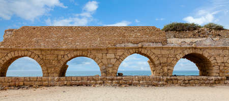 Roman aqueduct in Caesarea, Israel photo