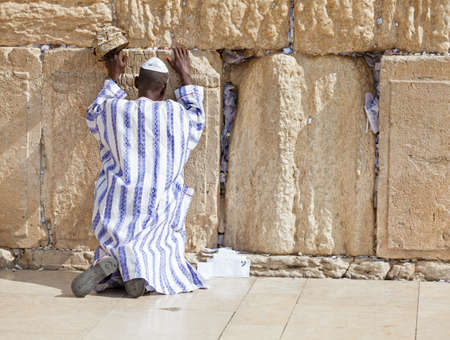 JERUSALEM - NOVEMBER 6 2012 - Jewish man prays at the Western Wall. The Western Wall a.k.a. the Wailing Wall is an important Jewish religious site located in the Old City of Jerusalem, Israel, November 6, 2012