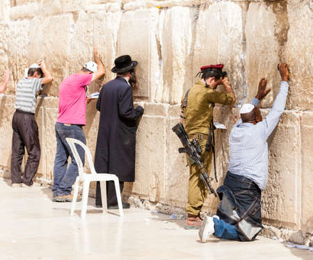 JERUSALEM - NOVEMBER 6 2012 - Jewish men pray at the Western Wall. The Western Wall a.k.a. the Wailing Wall is an important Jewish religious site located in the Old City of Jerusalem, Israel, November 6, 2012