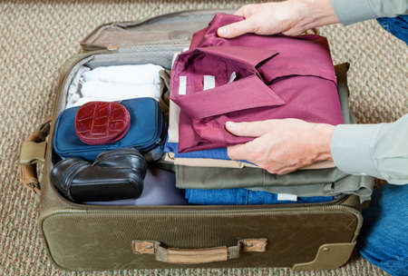 Packing suitcase Stockfoto
