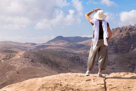 woman back view: Woman is admiring a view of Jordanian desert Stock Photo