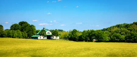 Horse farm with stables and pasture