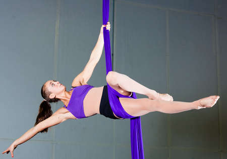 Gymnast performing aerial exercises photo