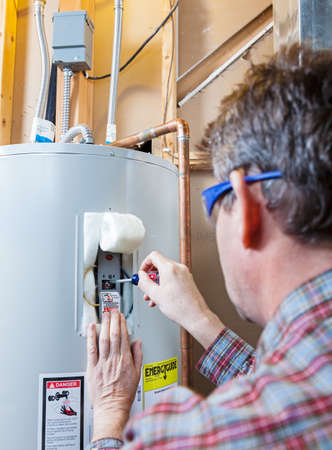 Water heater maintenance Stock Photo - 20997581