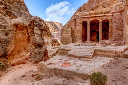 Ancient tomb known as Garden Tomb carved in the rock in Petra, Jordan photo