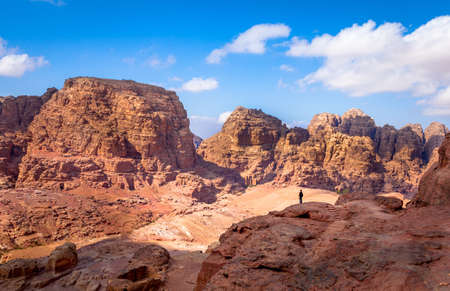 View of desert and ancient tombs carved in the rock in Petra, Jordan 写真素材