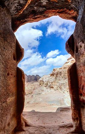 View of the desert from a tomb doorway in Petra, Jordan