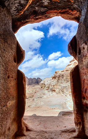View of the desert from a tomb doorway in Petra, Jordan
