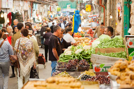 Jerusalem, Israel - November 15, 2012 - people are shopping at Mahane Yehuda - famous market in Jerusalem Stock Photo - 25454886