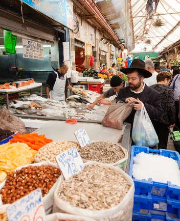 merchant: Jerusalem, Israel - November 15, 2012 - people are shopping at Mahane Yehuda - famous market in Jerusalem