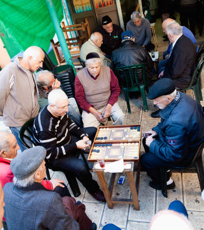 backgammon: Jerusalem, Israel - November 15, 2012 - men play backgammon game in a back alley of Mahane Yehuda, famous Jerusalem market