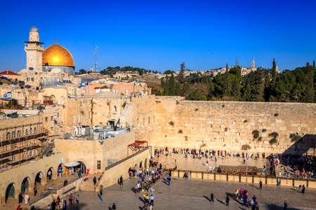 stone wall: JERUSALEM, ISRAEL - NOVEMBER 15, 2012: Western wall (Wailing Wall) and the Dome of the Rock in Jerusalem.  This is one of the most sacred places recognized by Judaism and has been a site of Jewish pilgrimage for many centuries.