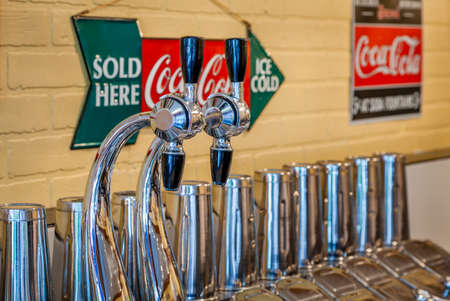 shop sign: MIDWAY, KENTUCKY, USA - JULY 06, 2013: Traditional 1950s soda fountain in a pharmacy shop in Midway, Kentucky. Editorial