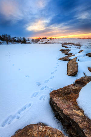 Sunset on a frozen lake in Central Kentucky Stock Photo