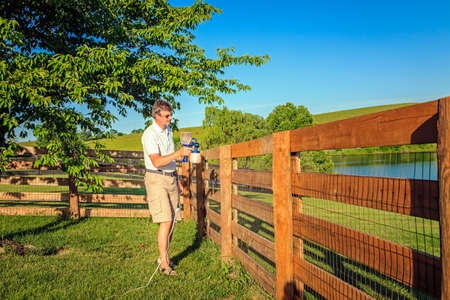 staining: Staining fence Stock Photo