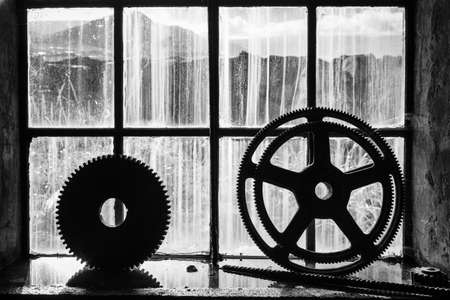 abandoned factory: Old gears in an abandoned metal shop in Iceland