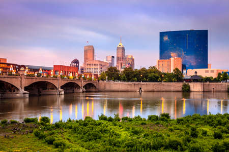 Indianapolis skyline and the White River at sunset Stock Photo - 32578544