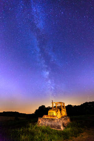 bulldozers: Bulldozer in a field with Milky Way in the backdrop