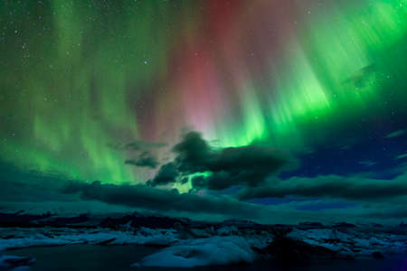 scenic landscapes: Aurora borealis over Jokulsarlon lagoon in Iceland Stock Photo