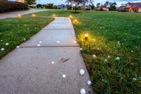 ice storm: Baseball size hail covering the ground after the storm Stock Photo
