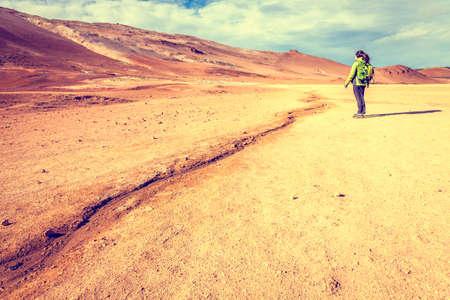 geothermal: Hiker in Hverir - geothermal field in Northern Iceland